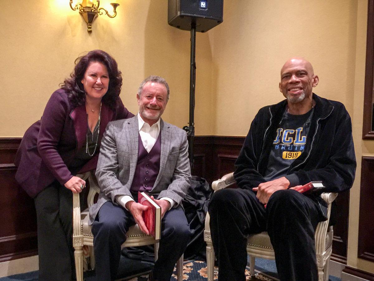 Kareem Abdul-Jabbar and Deborah Morales with Jarl Mohn, CEO of NPR