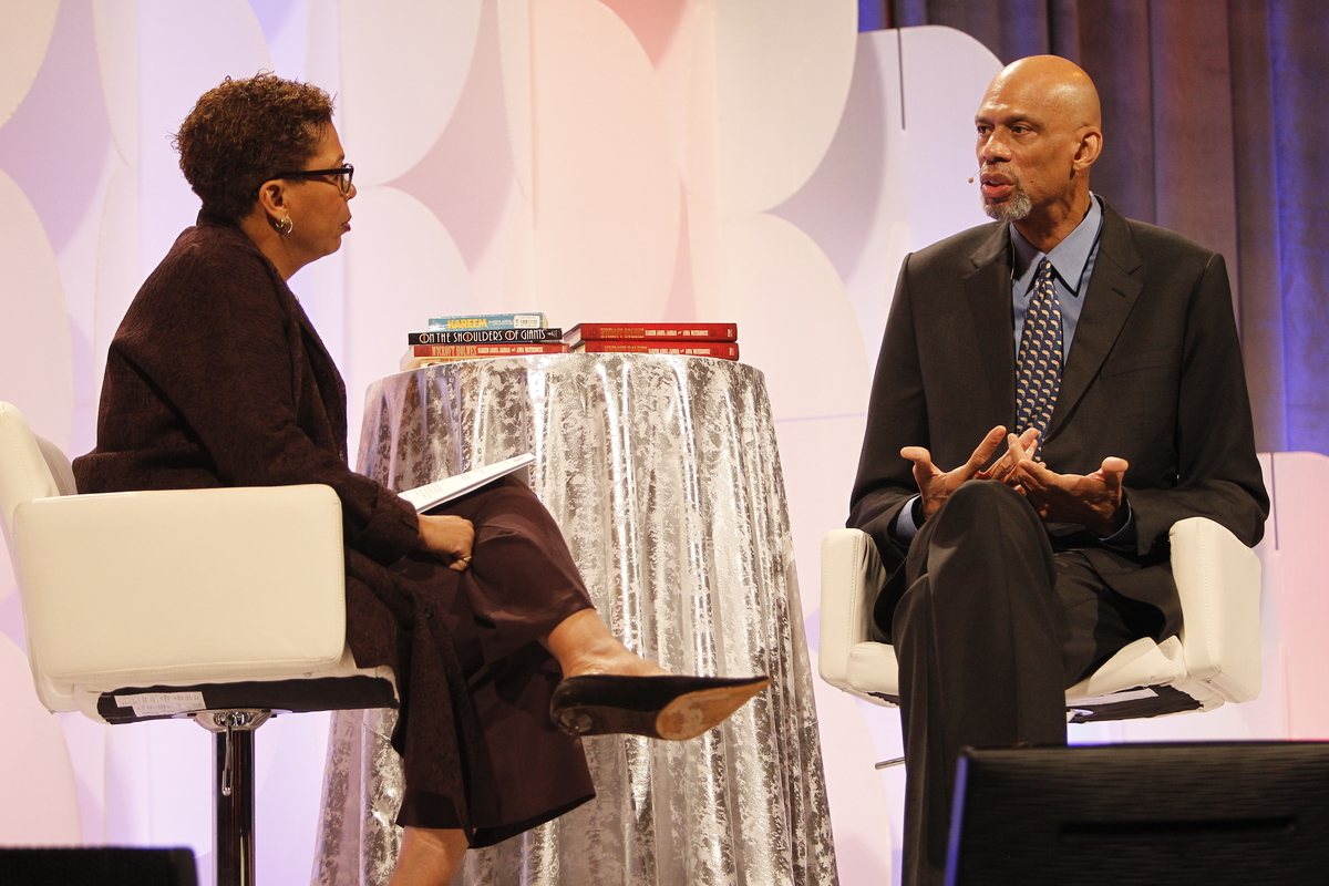 """Michel Martin, left, weekend host of NPR''s """"All Things Considered,"""" interviews NBA legend Kareem Abdul-Jabbar at the National Building Museum as part of NPR''s annual """"Weekend in Washington"""" on Friday, October 30, 2015 in Washington, DC. (Paul Morigi/AP Images for NPR)"""